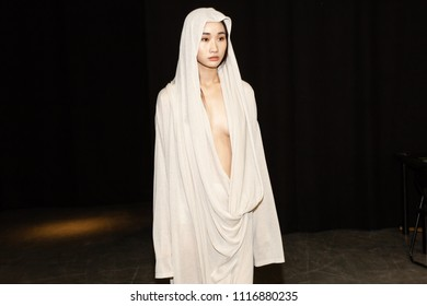 MILAN, ITALY - JUNE 18: Beautiful model poses in the backstage just before Sartorial Monk show during Milan Men's Fashion Week on JUNE 18, 2018 in Milan.