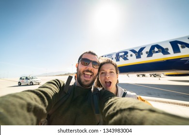 MILAN, ITALY- june 19, 2018: Couple passengers take selfie before boarding on Ryanair flight from Milan Italy on a sunny day. Ryanair is the most important budget low-cost airline in the world.