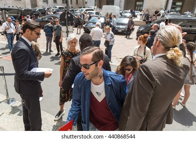MILAN, ITALY - JUNE 19: Fashionable people gather outside Ferragamo fashion show building during Milan Men's Fashion Week on JUNE 19, 2016 in Milan.