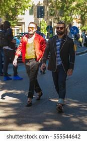 MILAN, ITALY - JUNE 20: Fashionable man poses after ARMANI fashion show during Milan Men Fashion Week , street style on JUNE 20, 2016 in Milan.