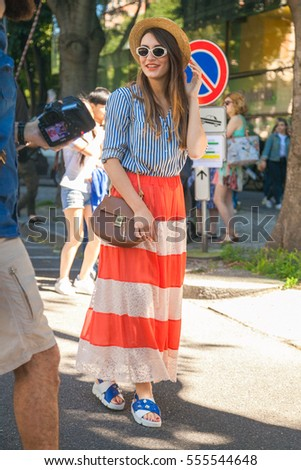 MILAN, ITALY - JUNE 20  Fashionable woman poses after ARMANI fashion show  during Milan Men Fashion Week , street style on JUNE 20, 2016 in Milan. -  Image 67b032a176