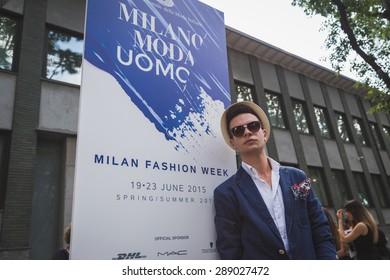 MILAN, ITALY - JUNE 20: People gather outside Armani fashion show building for Milan Men's Fashion Week on JUNE 20, 2015 in Milan.