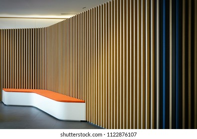 Milan, Italy -june 2018: Interior design of modern waiting room with wood cladding