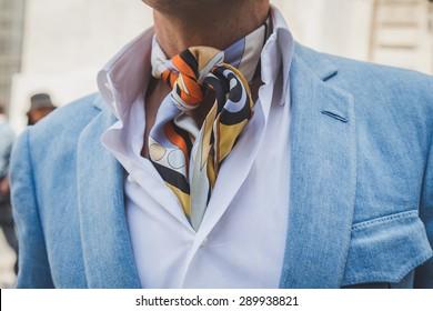 MILAN, ITALY - JUNE 21: Detail of an elegant man posing outside Ferragamo fashion show building for Milan Men's Fashion Week on JUNE 21, 2015 in Milan.