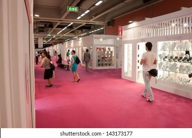 MILAN, ITALY - JUNE 21: People at SposaItalia exhibition in Milan JUNE 21, 2013. People visit SposaItalia exhibition, international presentation of bridal and formal wear according to Italian style.