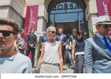 MILAN, ITALY - JUNE 21: People gather outside Ferragamo fashion show building for Milan Men's Fashion Week on JUNE 21, 2015 in Milan.
