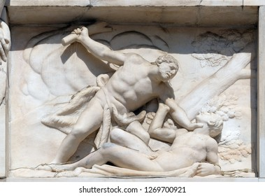 MILAN, ITALY - JUNE 22, 2018: Cain killing Abel, marble relief on the facade of the Milan Cathedral, Duomo di Santa Maria Nascente, Milan, Lombardy, Italy