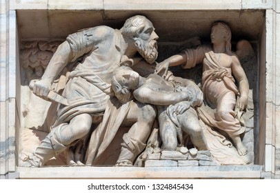 MILAN, ITALY - JUNE 22, 2018: Sacrifice of Isaac, marble relief on the facade of the Milan Cathedral, Duomo di Santa Maria Nascente, Milan, Lombardy, Italy
