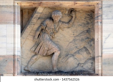 MILAN, ITALY - JUNE 22, 2018: Samson carries away the Gates of Gaza. Marble relief on the facade of the Milan Cathedral, Duomo di Santa Maria Nascente, Milan, Lombardy, Italy
