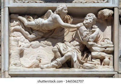 MILAN, ITALY - JUNE 22, 2018: Elijah in the Wilderness, marble relief on the facade of the Milan Cathedral, Duomo di Santa Maria Nascente, Milan, Lombardy, Italy