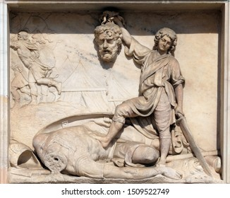 MILAN, ITALY - JUNE 22, 2018: David with the Head of Goliath, marble relief on the facade of the Milan Cathedral, Duomo di Santa Maria Nascente, Milan, Lombardy, Italy