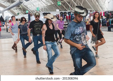 MILAN, ITALY - JUNE 22: People dance at Rocking The Park, event dedicated to American music and lifestyle of the 40s, 50s and 60s on JUNE 22, 2014 in Milan.