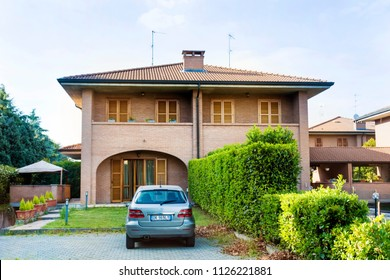 MILAN, ITALY  - JUNE 22 : Traditional Italian Style House with Garden and Car Parked in Front of the House