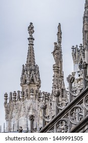 MILAN, ITALY - JUNE 23, 2016: Spires on roof top of Milan Cathedral. Milan Cathedral (Duomo di Milano) dedicated to St Mary of the Nativity, with Gothic and Lombard Romanesque style.
