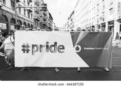 MILAN, ITALY - JUNE 24: People at Pride parade in Milan JUNE 24, 2017. Thousands of people march in the city streets for the annual Pride parade, claiming equality and legal rights.