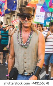 MILAN, ITALY - JUNE 25: People at Pride parade in Milan JUNE 25, 2016. Thousands of people march in the city streets for the annual Pride parade, claiming equality and legal rights.