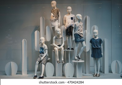 Milan, Italy - June 28, 2016: Window display of a children clothing shop