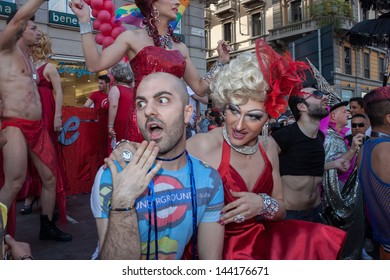 MILAN, ITALY - JUNE 29: People at gay pride parade in Milan JUNE 29, 2013. Thousands of people march in the city streets for the annual gay pride parade, claiming equality and legal rights.