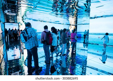 MILAN, ITALY - JUNE 3, 2015: People visit Expo 2015, universal exposition on the theme of food - Tourists watching video projection inside Italy Pavilion