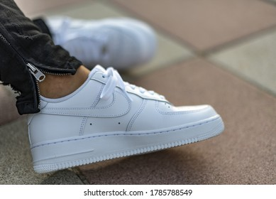 Milan, Italy - June 3, 2019: Young man wearing a pair of Nike Air Force