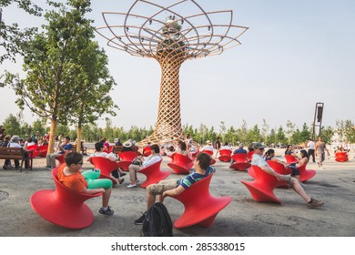 MILAN, ITALY - JUNE 5: People sit in front of Tree of Life at Expo, universal exposition on the theme of food on JUNE 5, 2015 in Milan.