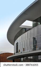 MILAN, ITALY - JUNE 9, 2015: Modern buildings of Milan in Porta Nuova district. Italy on June 9, 2015. Detail of glass circular building.