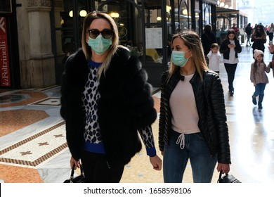 Milan, Italy, Lombardy - 25 February 2020: people in face masks to protect themselves from the corona virus epidemic on the streets of Milan