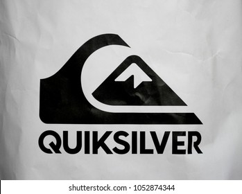 Milan, Italy / Lombardy - March 21 2018: Quiksilver Logo, symbol, printed on paper bag of the brand store, black and white, the company deals with equipment, clothing for surfing, extreme sports, sea,