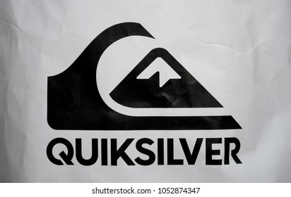 Milan, Italy / Lombardy - March 21 2018: Quiksilver Logo, symbol, printed on paper bag of the brand store, black and white, the company deals with equipment, clothing for surfing, extreme sports, sea