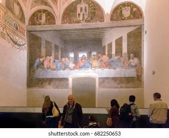 Milan, Italy - March 15, 2016 - Tourists visit the Last Supper by Leonardo da Vinci in the refectory of the Convent of Santa Maria delle Grazie
