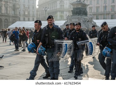 MILAN, ITALY - MARCH 16, 2017 : A group of Italian riot police standing in front of Duomo Cathedral in Milan