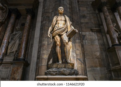Milan, Italy - March 17, 2018: Statue of the skinned St. Bartholomew (wearing his own skin) in Milan Cathedral, Duomo di Milano, one of the largest churches in the world.