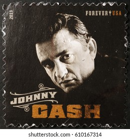 Milan, Italy - March 19, 2017: Johnny Cash portrait on american postage stamp