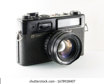 Milan, Italy - March 19, 2020: close up on a very old vintage Yashica film camera, isolated on white background.