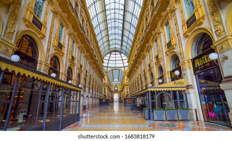 Milan, Italy - March 19, 2020: Empty gallery of Vittorio Emanuele 2 next to the Piazza Duomo. Quarantine from the Covid 19 viral corona in Italy. People. Quarantine in Milan. fish eye. Architecture