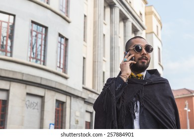 MILAN, ITALY - MARCH 2: Man poses outside Alberto Zambelli fashion show building for Milan Women's Fashion Week on MARCH 2, 2015  in Milan.