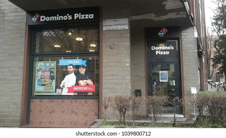 Milan, Italy - March 2018: Domino's Pizza Shop with delivery scooters. Chain stores.