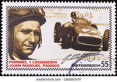 Milan, Italy – March 21, 2019: Racing driver Juan Manuel Fangio on postage stamp