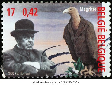 Milan, Italy – March 21, 2019: Portrait of Rene Magritte on postage stamp