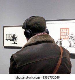 Milan, Italy - March 21, 2019: visitors observe Banksy's street works in an unauthorized exhibition in a museum.