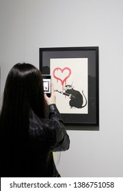 Milan, Italy - March 21, 2019: Visitors take photos in a Banksy unauthorized exhibition.