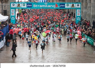 MILAN, ITALY - MARCH 23: Athletes take part in Stramilano, traditional half marathon through the city streets on MARCH 23, 2014 in Milan.