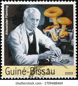 Milan, Italy - March 25, 2020: Portrait of Alexander Fleming on stamp of Guinea Bissau