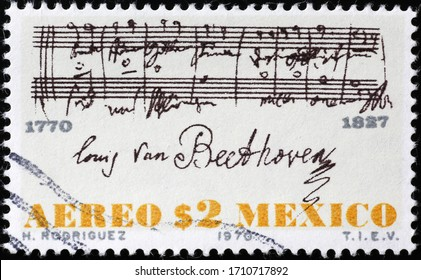 Milan, Italy - March 25, 2020: Sheet music signed by Beethoven on postage stamp