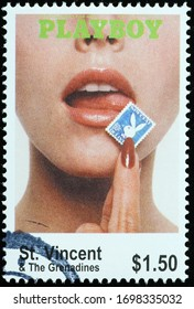 Milan, Italy - March 26, 2020: Old cover of Playboy magazine on postage stamp