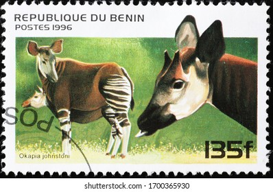 Milan, Italy - March 26, 2020: Two okapies on postage stamp of Benin