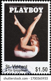 Milan, Italy - March 26, 2020: Vintage cover of Playboy magazine on postage stamp