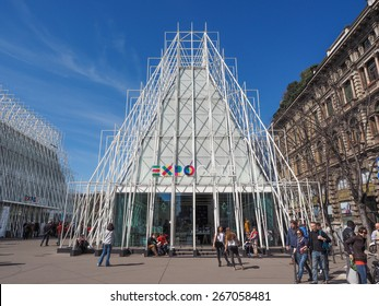 MILAN, ITALY - MARCH 28, 2015: Tourists in front of the Expo Gate information centre in Milan as part of the Expo Milano 2015 international exhibition