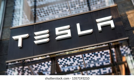 Milan, Italy - March 30, 2019: Tesla motor company logo sign on the flagship store in Gae Aulenti square.
