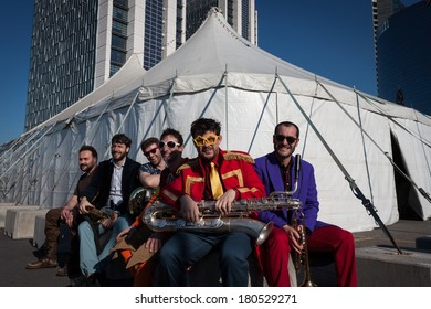 MILAN, ITALY - MARCH 6: Musicians posing outside the big top at Milan Clown Festival, international event dedicated to clowns and street theatre on MARCH 6, 2014 in Milan.
